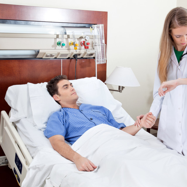 """Doctor checking the heartbeat"" stock image"