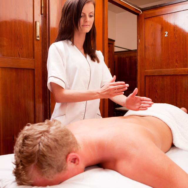 """Woman Giving Percussive Massage"" stock image"