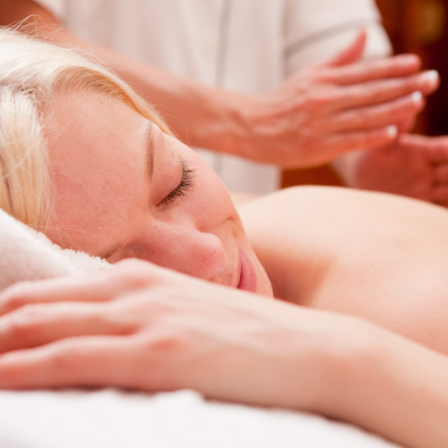 """Woman Receiving Percussive Massage"" stock image"