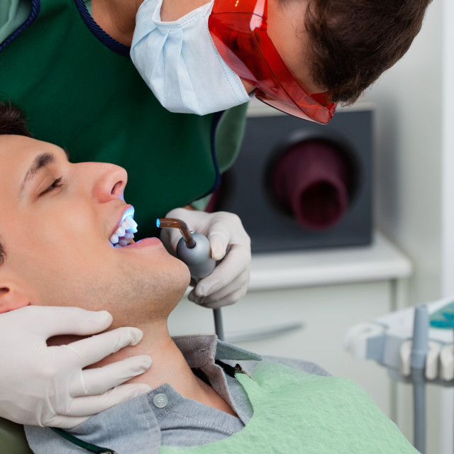 """Dentist working on tooth at dental clinic"" stock image"