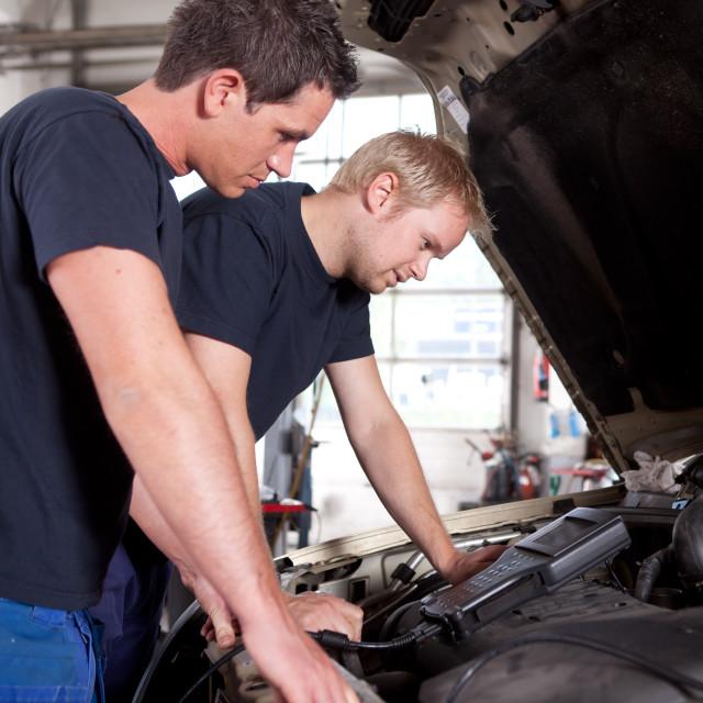 """Mechanics Team with Diagnostics Equipment"" stock image"