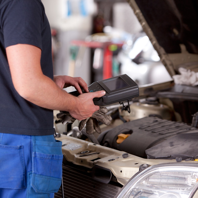 """Mechanic with Diagnostic Equipment"" stock image"