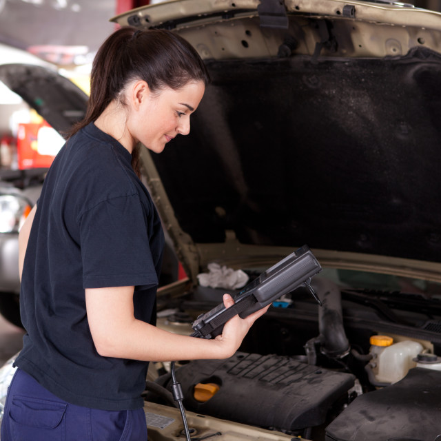 """Woman Mechanic with Diagnostics Tool"" stock image"