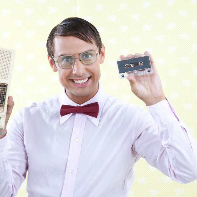 """Man Holding Old Audio Cassette"" stock image"