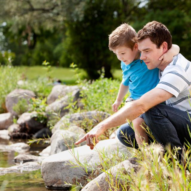 """""""Fashing and Son Playing Near Lake"""" stock image"""