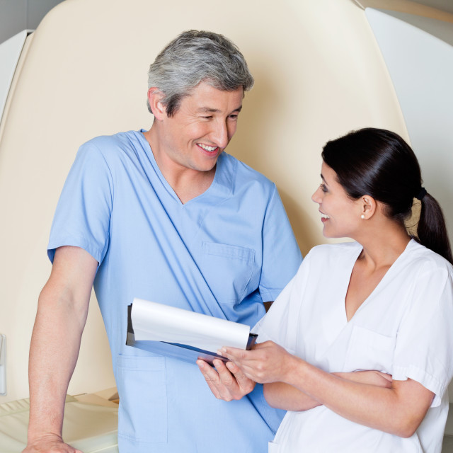 """""""Radiologic Technicians Smiling At Each Other"""" stock image"""
