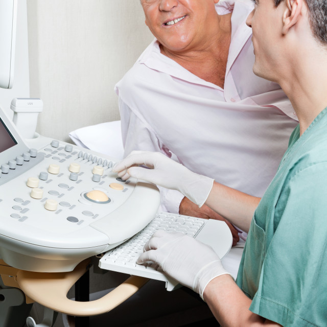 """""""Radiologic Technologist With Patient"""" stock image"""