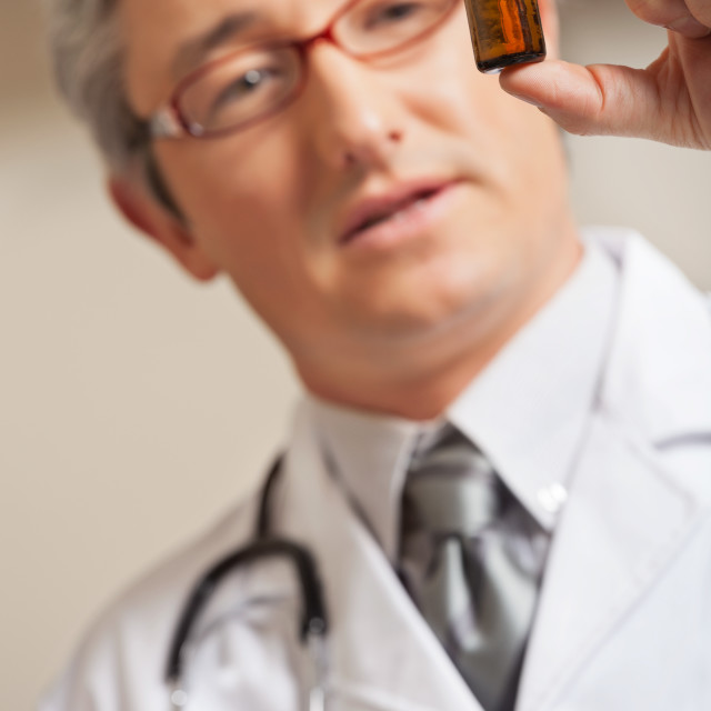 """Physician Holding Medicine Bottle"" stock image"