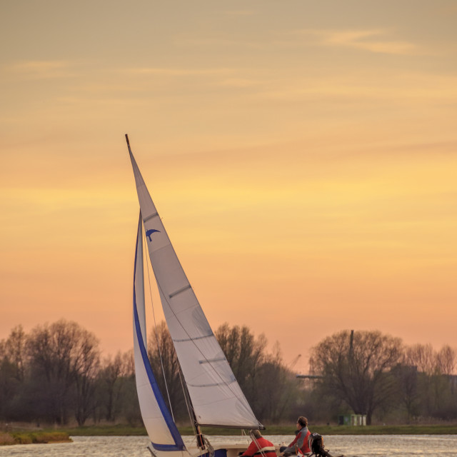 """Sailing at sunset"" stock image"