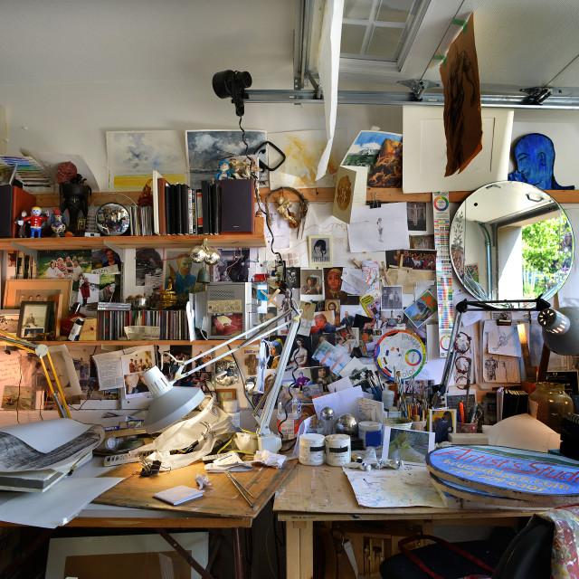 """Cluttered artist workspace studio"" stock image"