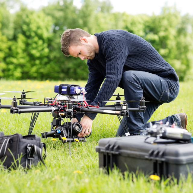 """Engineer Setting Camera On UAV Helicopter"" stock image"