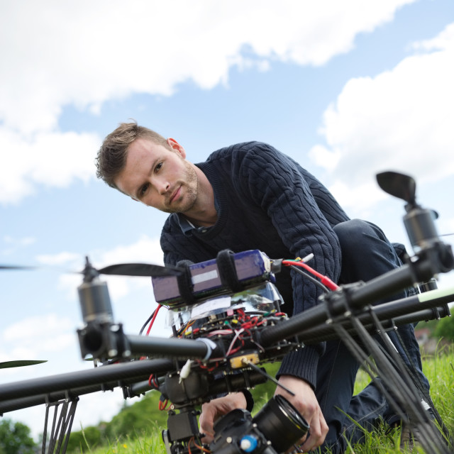 """""""Engineer Fixing Camera On UAV Helicopter"""" stock image"""