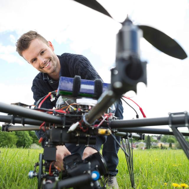 """Technician Assembling Camera On UAV Drone"" stock image"