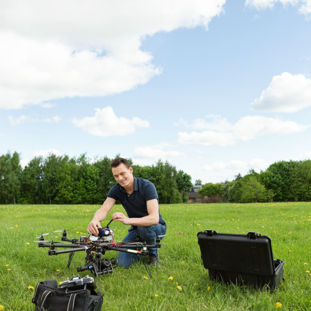 """Technician Preparing Multirotor Helicopter"" stock image"