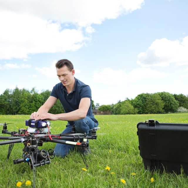 """""""Engineer Fixing UAV Drone in Park"""" stock image"""