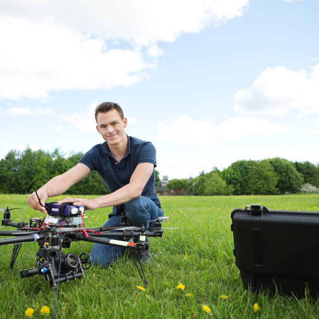 """Technician With Octocopter Drone in Park"" stock image"
