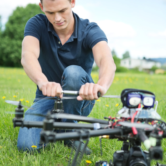 """Engineer Fixing Propeller Of UAV Drone"" stock image"