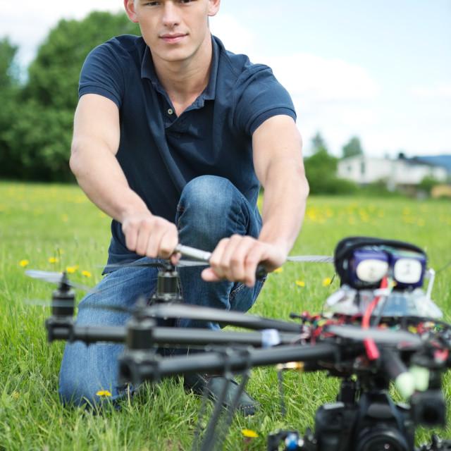 """Engineer Fixing Propeller Of UAV Spy Drone"" stock image"