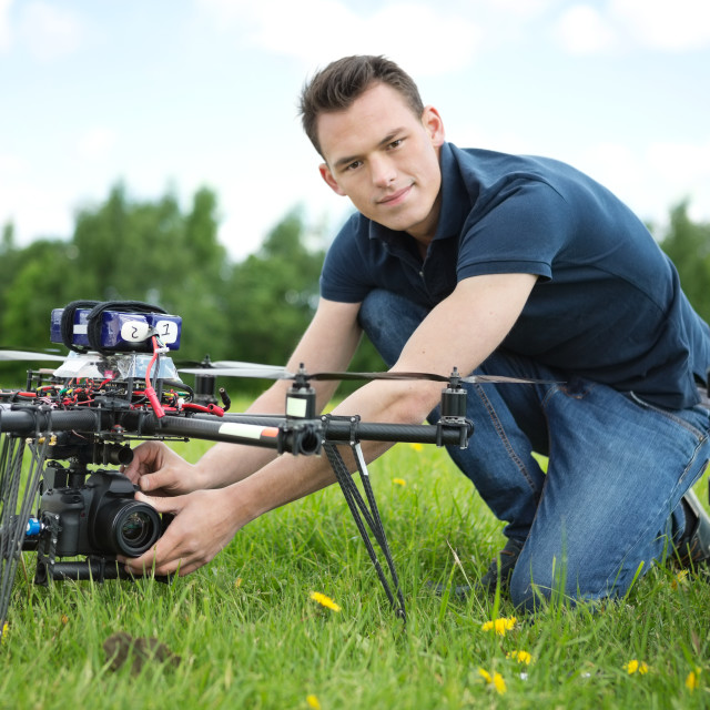 """""""Engineer Setting Camera On Photography Drone"""" stock image"""