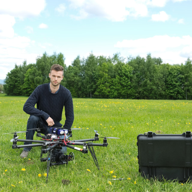 """Engineer With UAV Helicopter in Park"" stock image"
