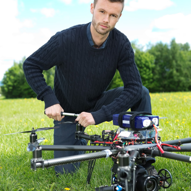 """Technician Fixing Propeller Of UAV Octocopter"" stock image"