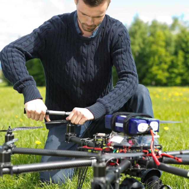 """""""Technician Assembling Propeller Of UAV"""" stock image"""