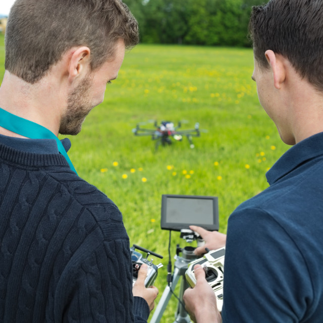 """Engineers Operating UAV Helicopter"" stock image"
