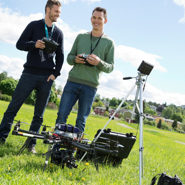 """Technicians Holding Remote Controls Of UAV"" stock image"
