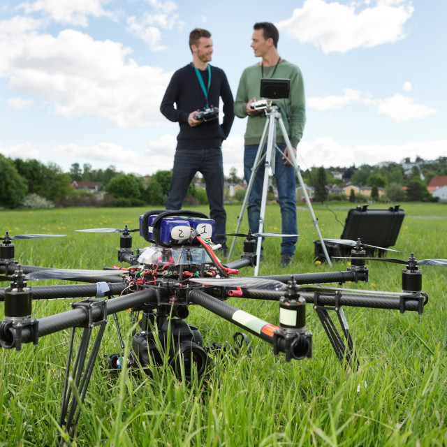 """UAV Helicopter And Technicians At Park"" stock image"