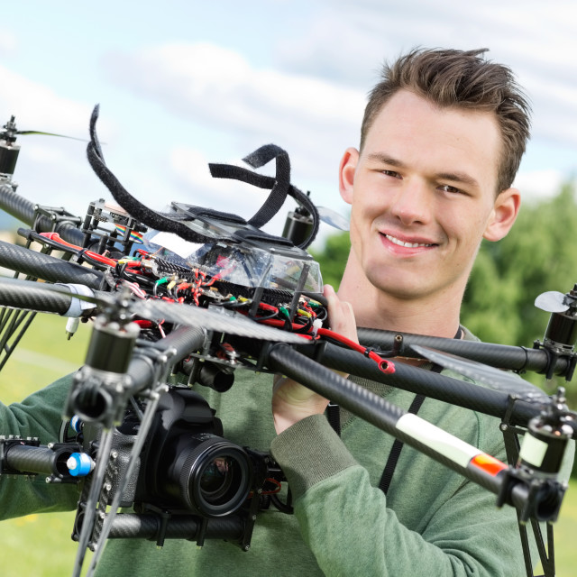 """Technician Holding UAV Octocopter"" stock image"