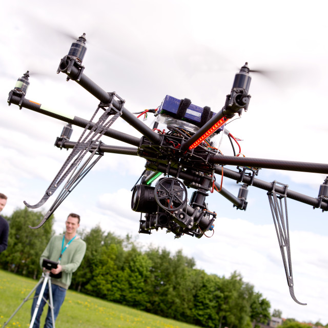 """""""Photographer and Pilot with UAV"""" stock image"""