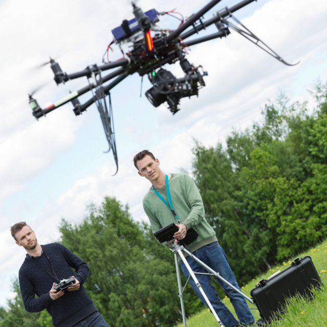 """Engineers Flying UAV Drone in Park"" stock image"