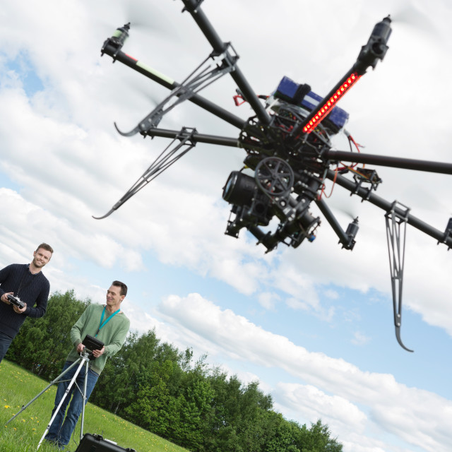 """Male Engineers Operating UAV Helicopter"" stock image"