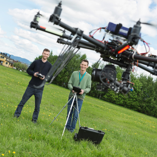 """""""Engineers Flying UAV Helicopter in Park"""" stock image"""
