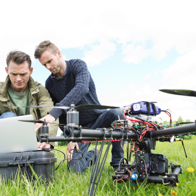 """Engineers Using Laptop By UAV Octocopter"" stock image"