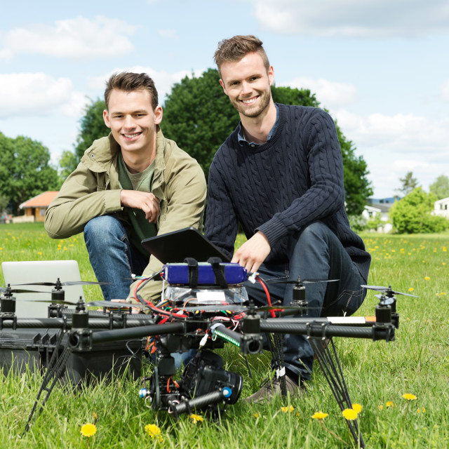 """Engineers With Laptop And Digital Tablet By UAV"" stock image"