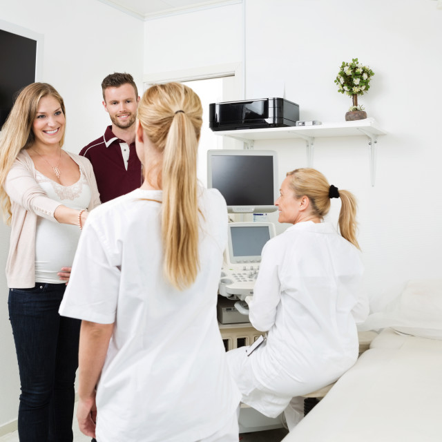 """""""Couple Visiting Gynecologist For Routine Checkup"""" stock image"""