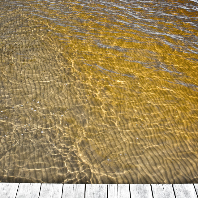 """""""Yellow ocean water discolored by clean sediments"""" stock image"""