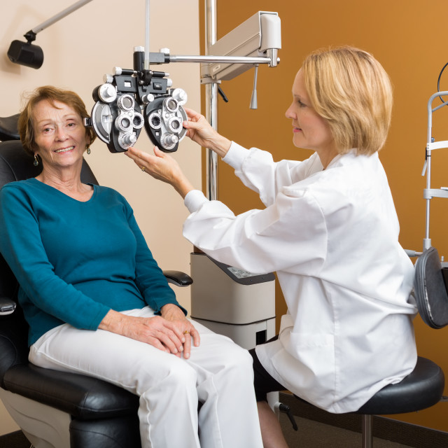 """Eye Specialist Adjusting Phoropter For Woman"" stock image"