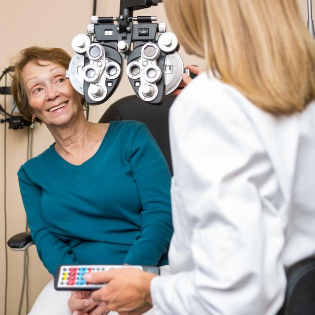 """Happy Senior Woman Undergoing Eye Checkup"" stock image"