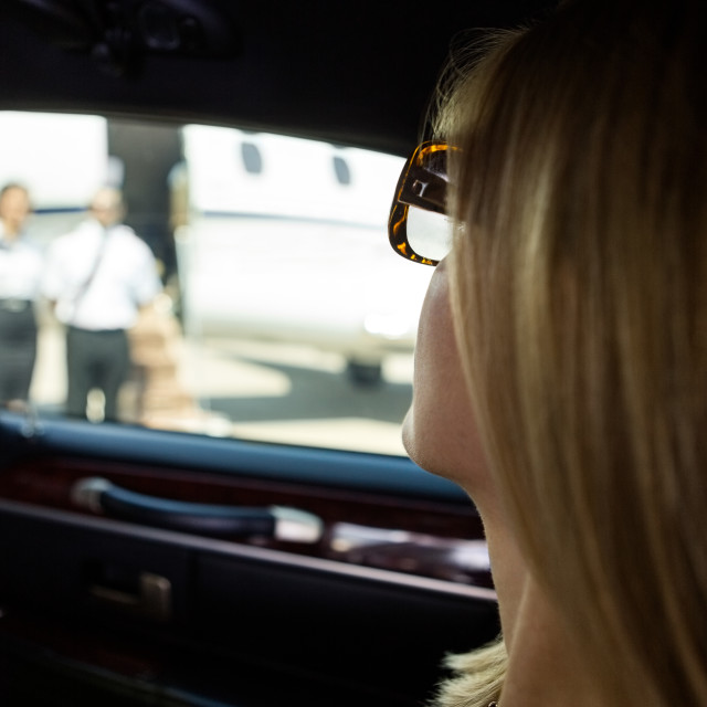 """Woman In Limousine At Airport Terminal"" stock image"