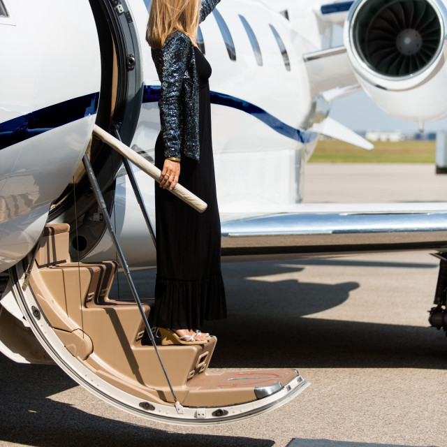 """""""Woman Stepping Out Of Private Jet"""" stock image"""