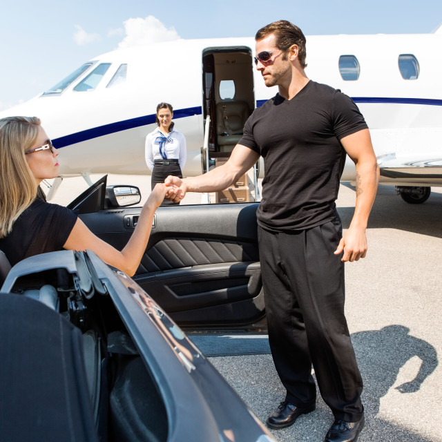"""""""Bodyguard Helping Elegant Woman Stepping Out Of Car"""" stock image"""