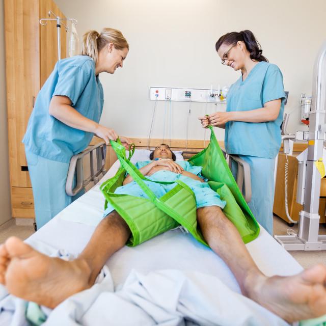 """Nurses Preparing Male Patient Before Transferring Him On Sling L"" stock image"
