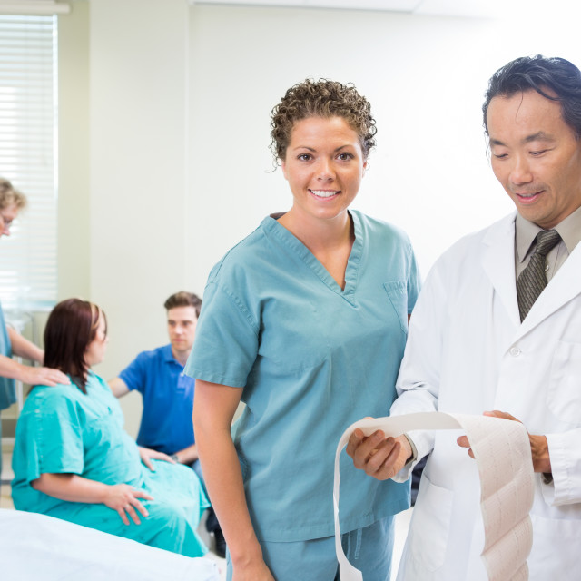 """Doctor and Nurse Examin CTG report"" stock image"