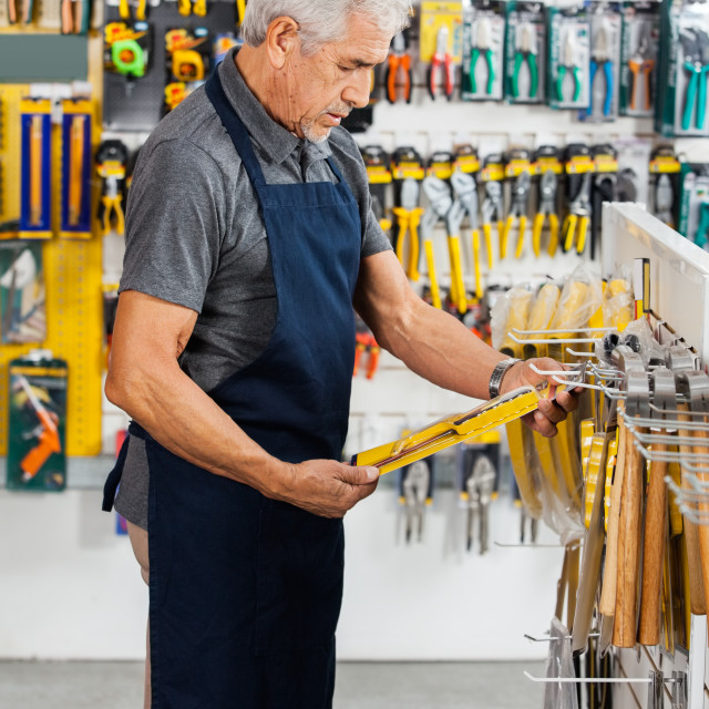 """""""Salesperson Working In Hardware Store"""" stock image"""