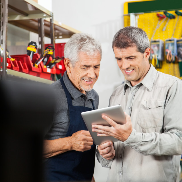 """""""Salesperson And Customer Using Digital Tablet"""" stock image"""