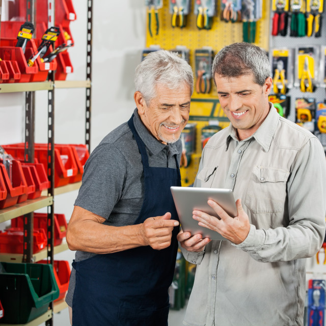 """""""Salesperson And Customer Using Tablet Computer"""" stock image"""