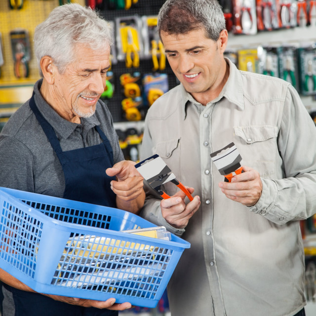 """""""Salesperson Assisting Customer In Buying Pliers"""" stock image"""