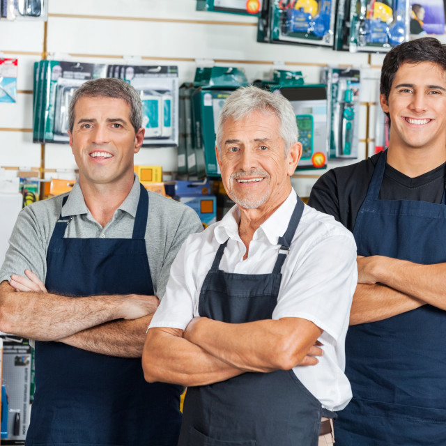 """Confident Salesmen In Hardware Store"" stock image"